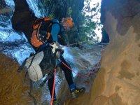 Rappelling by moistened rocks