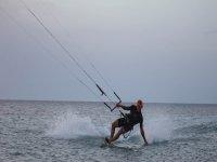 man playing the water while practicing kitesurfing.JPG