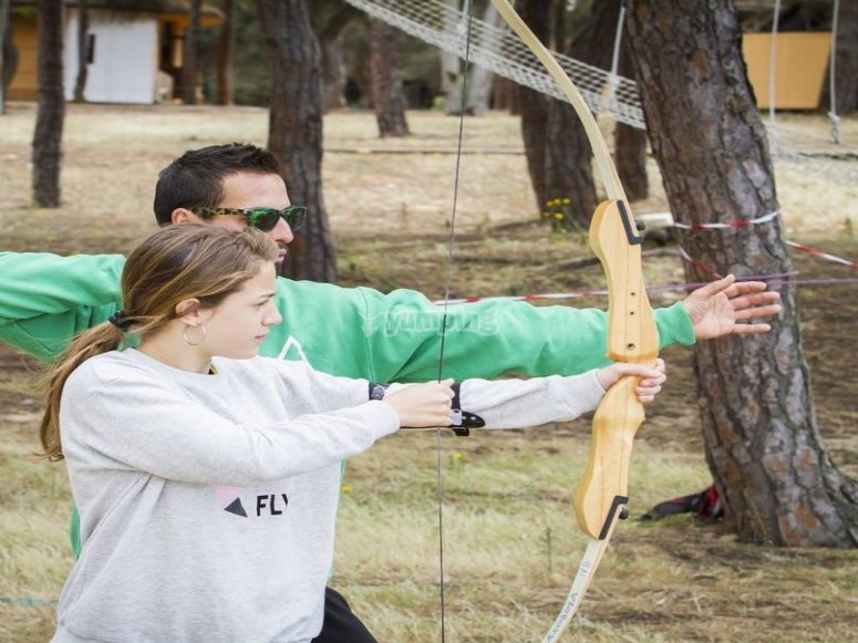 Instructor and girl in archery