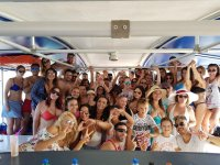 Group party enjoying themselves on the catamaran in Alicante