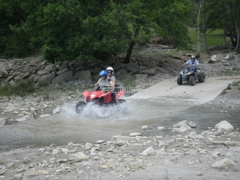 Crossing the river on a quad
