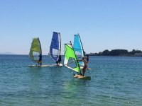 Children doing windsurfing in Cangas