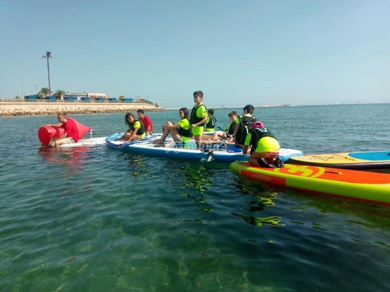 Los mas peques en Denia practicando Paddle Surf