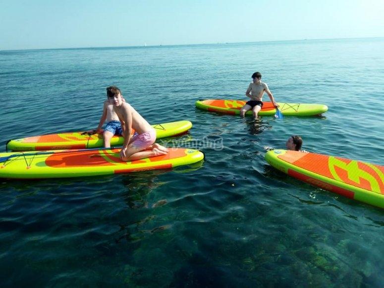 Practicar paddle surf en Denia