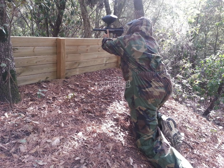 Protecting themselves behind wood in paintball
