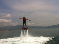 Man in the air while practicing flyboard