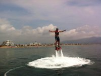 Man practicing flyboard with jets under his feet