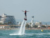 Man flying in the air while practicing flyboard