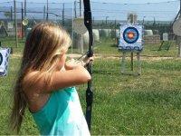 Girl testing archery