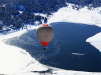Fly on a balloon over a snow-covered mountain