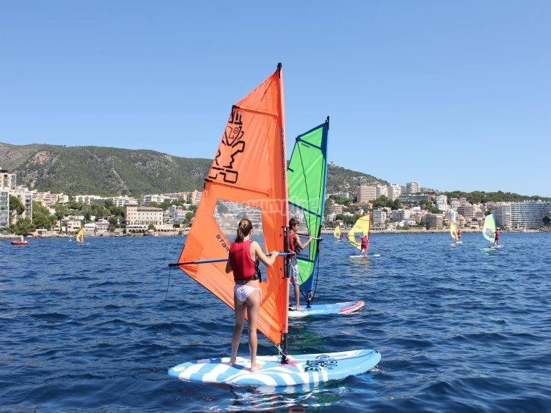 Children doing windsurfing in Port Calanova