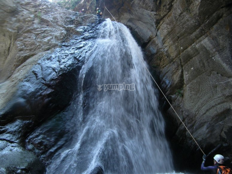 Canyoning with waterfall