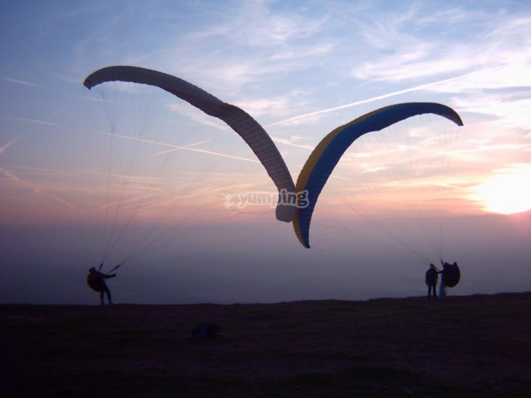 Folding the sails of the paraglider
