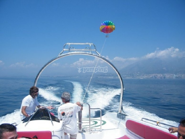 Parascending in the mountains with Marbella in the back