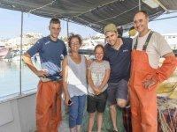 Turisti con pescatori