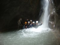 Group of friends doing canyoning