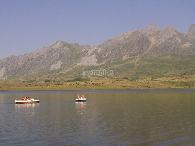 Pedal boats with the mountains in the background