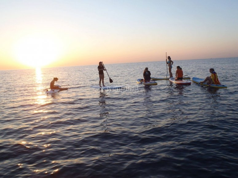 Paddling with SUP at dawn
