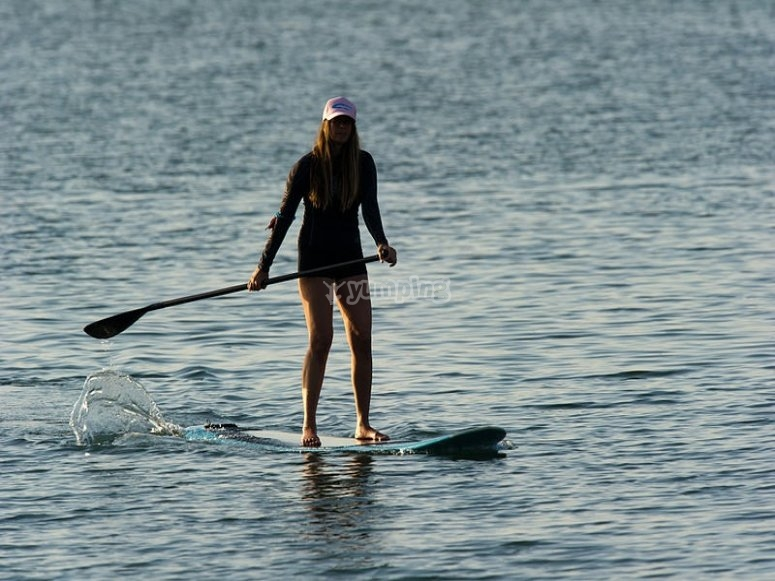 Woman practicing paddle surfing in Tarragona