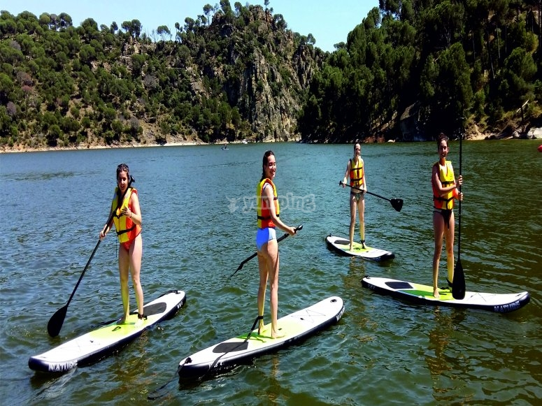 Paddle surfing for team building in San Juan reservoir