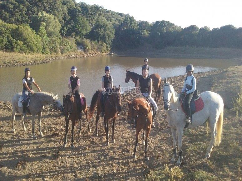 Group of children on horseback ride along the Guadalhorce River