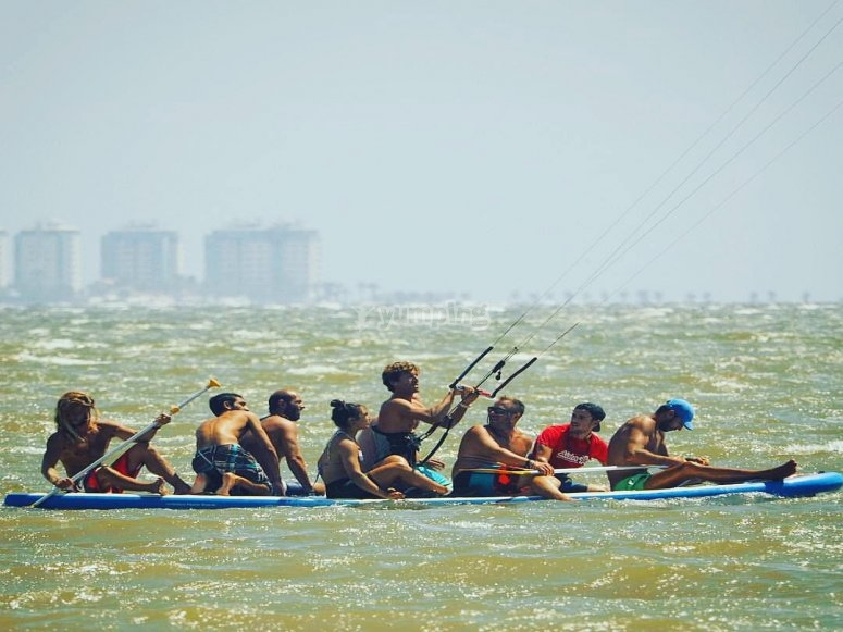 Group on top of the Big SUP board