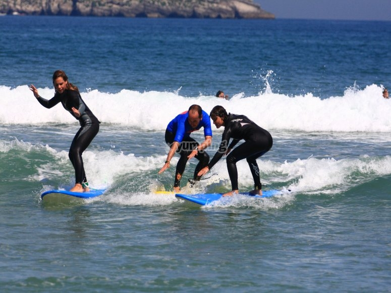 Surfing baptism in Somo