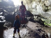 father and child inside a cave