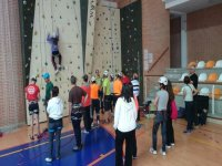 people learning to climb on a rock wall