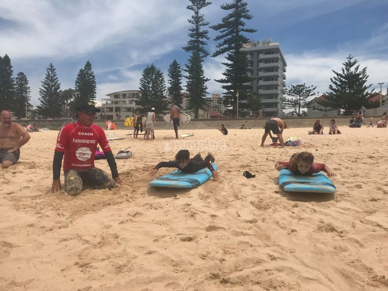 Learning how to surf on the sand