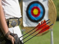 archer with some arrows with a background target