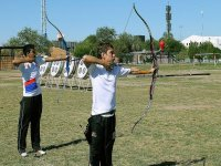 young people practicing shooting with bow