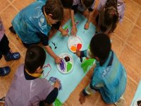 children painting with watercolors