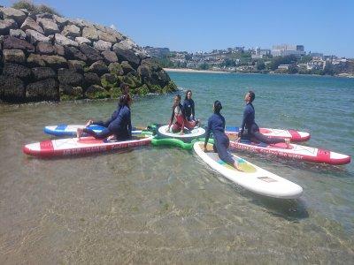 Paddle surf y yoga en el agua Playa Santa Cristina