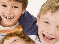 las caras de tres ninos