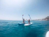 Paddle surf con amigos en la playa de Burriana