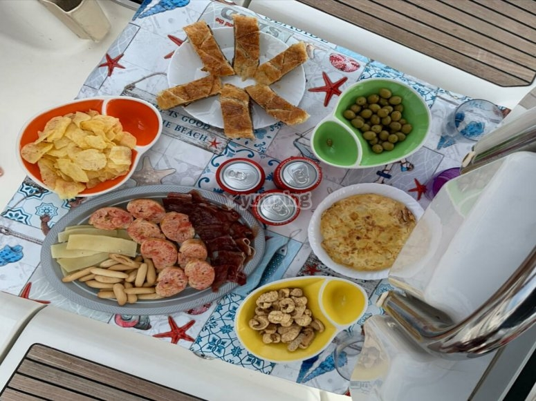 Snack aboard the sailboat in Sitges