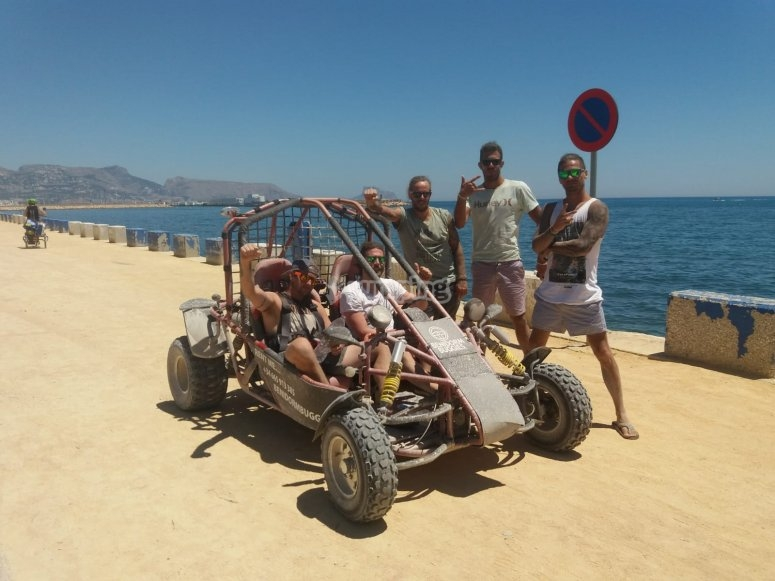 Friends next to the buggy in Benidorm
