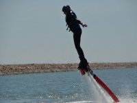 girl keeping balance while practicing flyboard