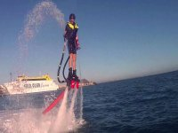 Man about to dive into the water while practicing flyboard