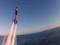 Man flying while practicing flyboard