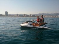 Couple in the jet ski in the Mediterranean Sea