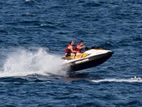 Guys on jet skis in the coast of Catalunya