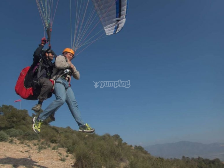 Flying in paragliding through Alhama de Murcia
