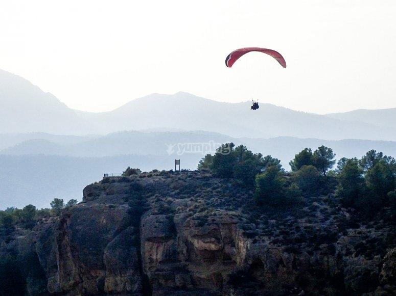Fly paragliding through Alhama de Murcia