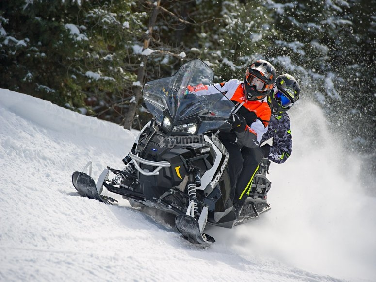 Snowmobile route for two through the Tena Valley