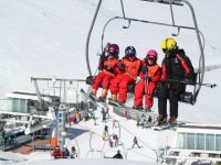 Instructor with students at the ski lift