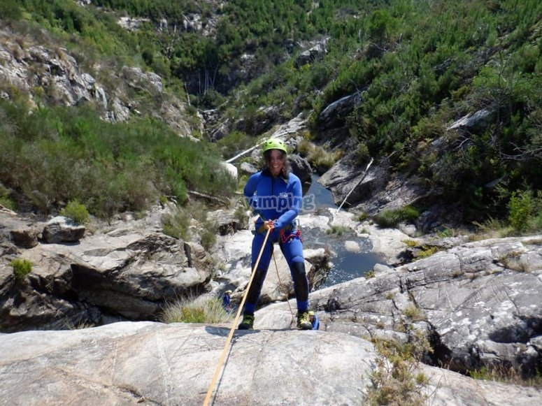 Adventurer abseiling in the canyon of the Verdugo River