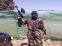 boy with all the equipment to play paintball