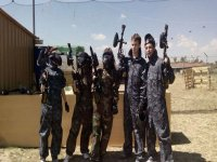 group of friends ready to play paintball